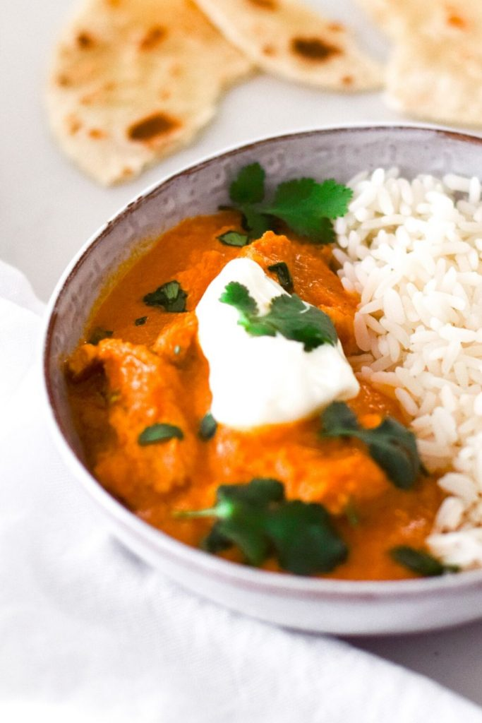 Easy Butter Chicken in a white bowl with rice