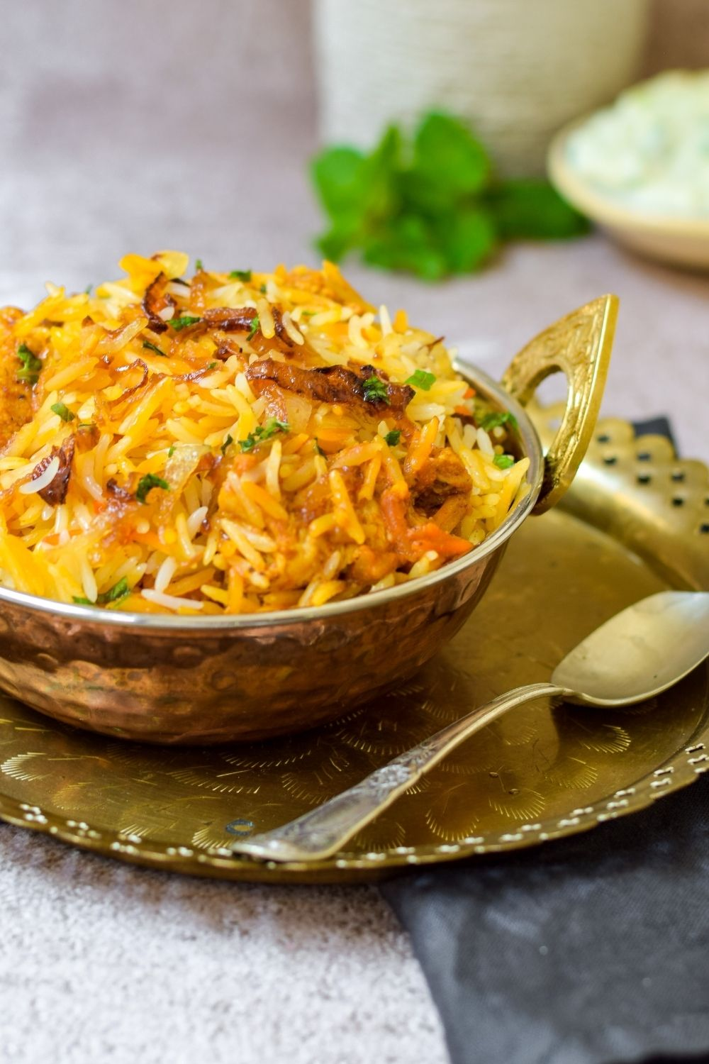 Spicy Butter Chicken Biryani in a copper bowl