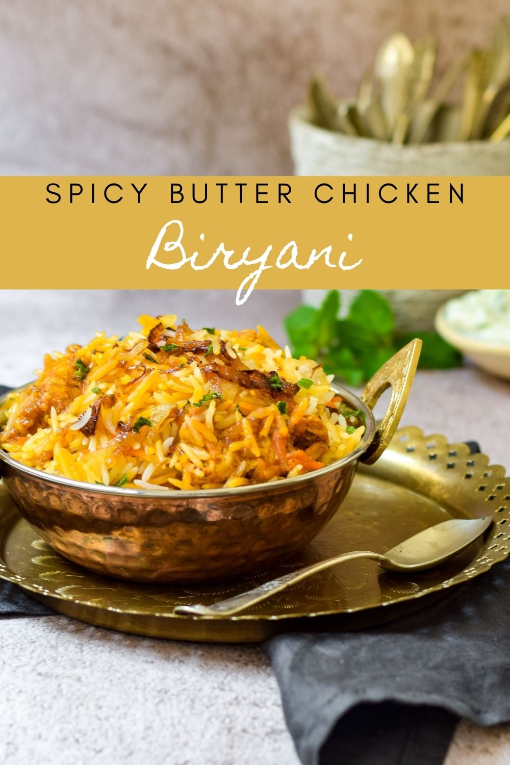 Spicy Butter Chicken Biryani in a copper dish