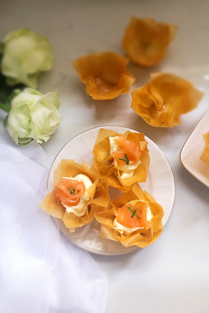 Phyllo cups filled with a cream cheese filling and topped with Salmon