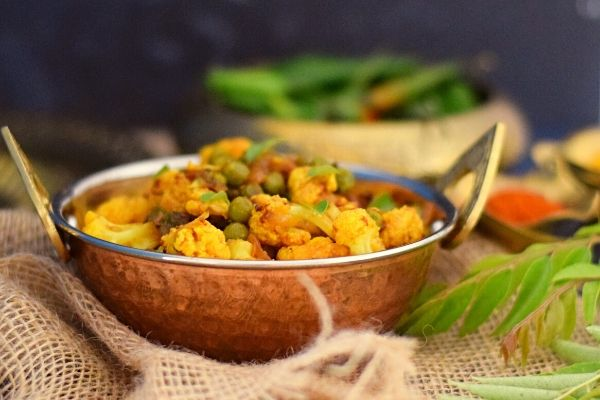 Cauliflower and Pea Curry in a metal bowl