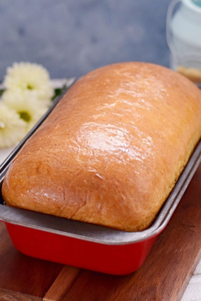 Freshly baked bread in a loaf pan