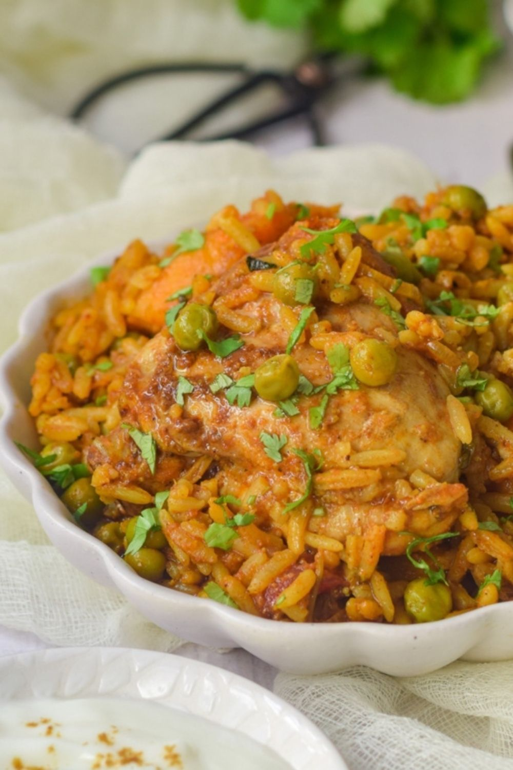Easy Chicken Akni in a white bowl