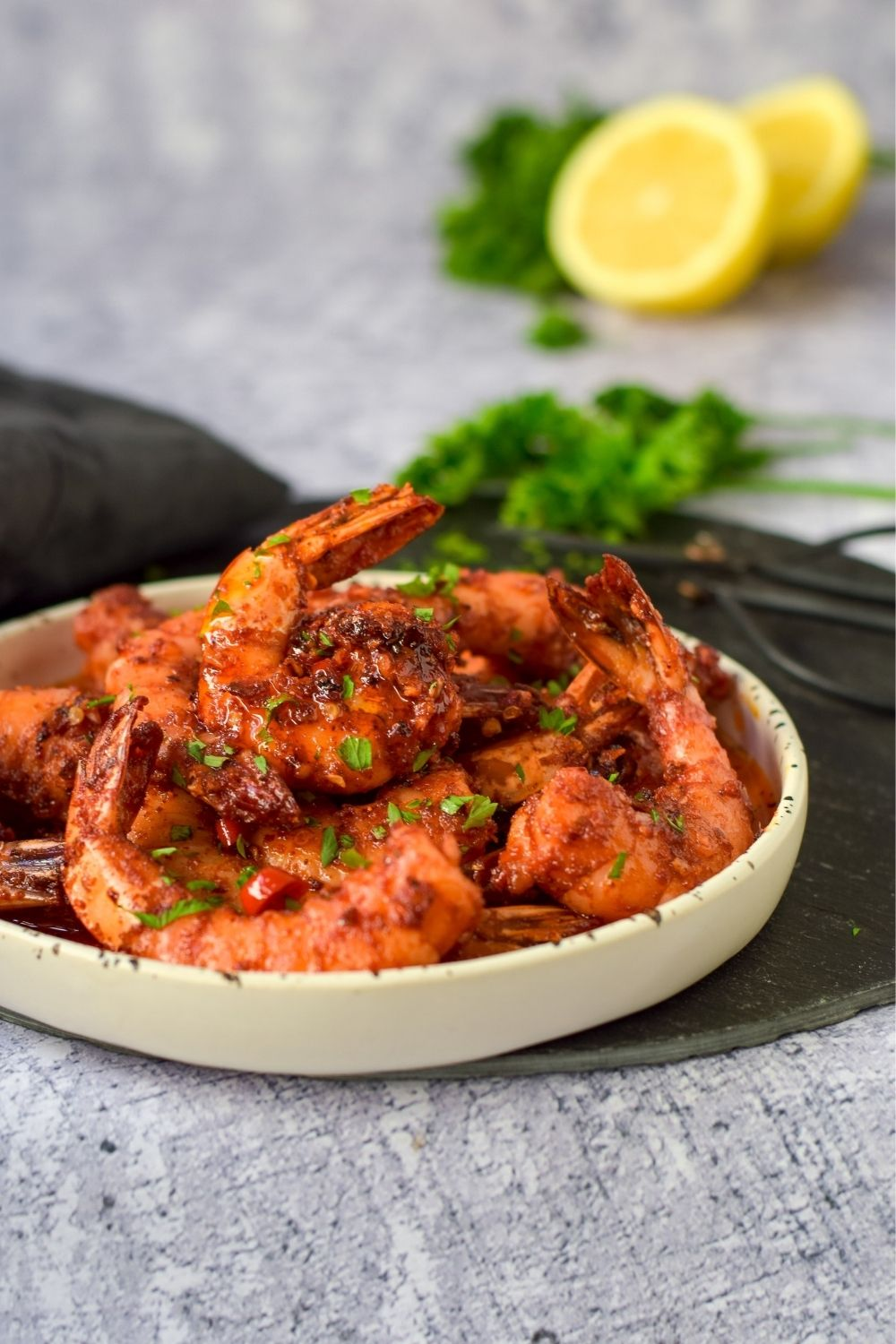 Chilli Garlic Butter Prawns in a white plate