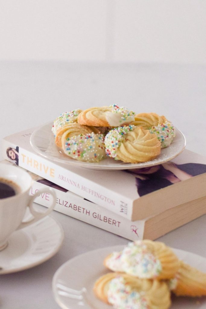 Butter Cookies on a plate on top of books