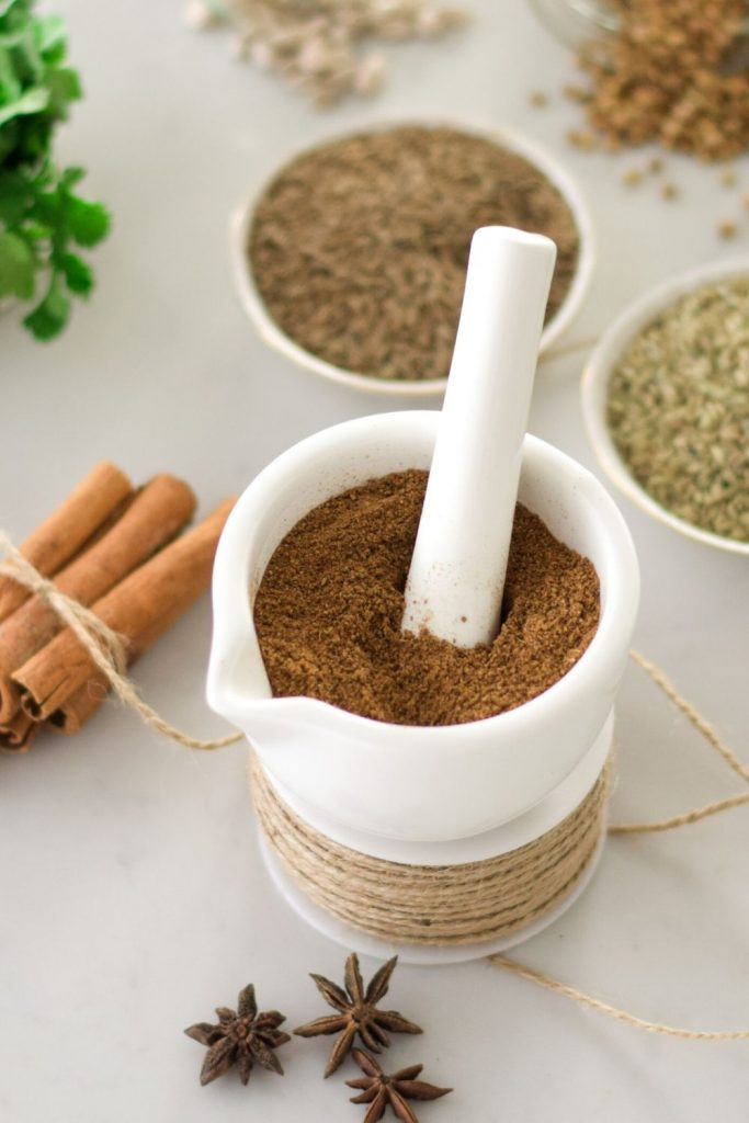 Garam Masala, Indian spice in a white pestle and mortar
