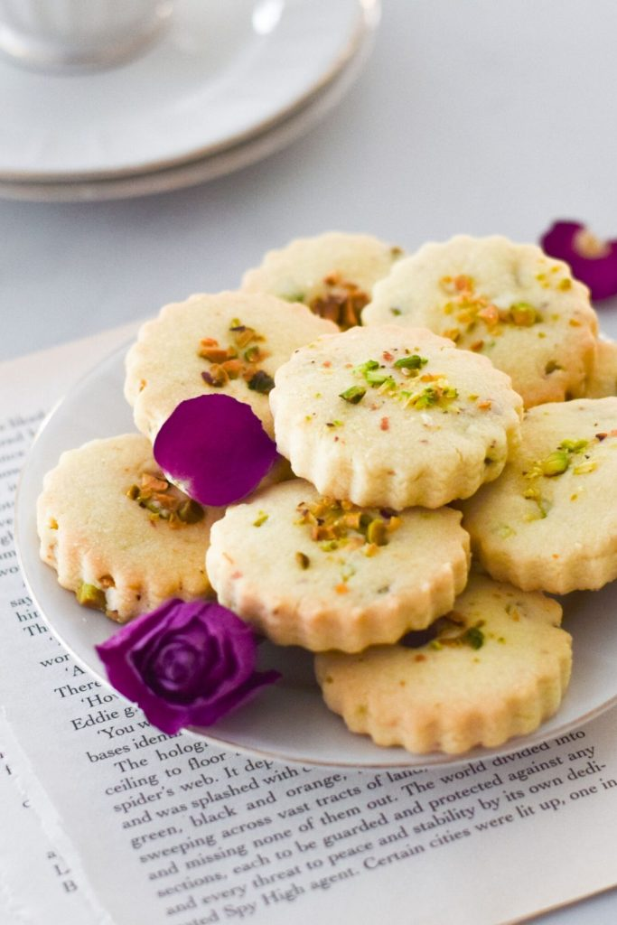 Rose Pistachio Shortbread Cookies on a white plate