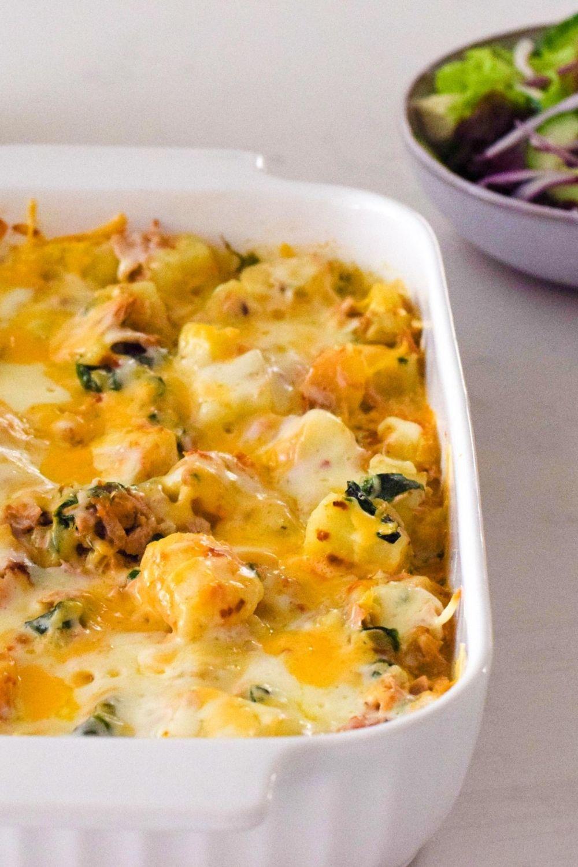 Tuna Potato Spinach Bake in a white oven dish