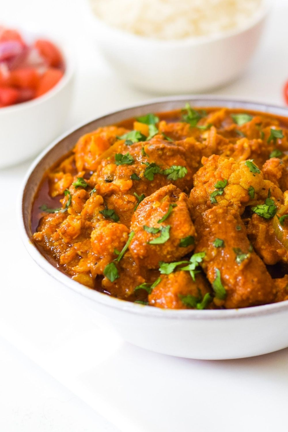Cauliflower and Chicken Curry in a white bowl