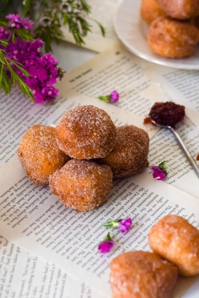 Doughnut Holes on paper with flowers on left and jam on right
