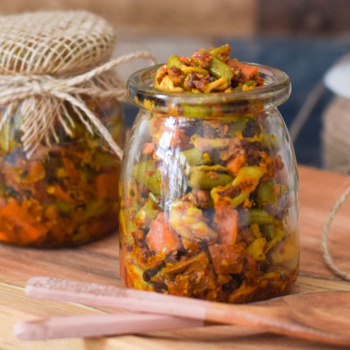 indian mixed vegetable pickle in glass bottles