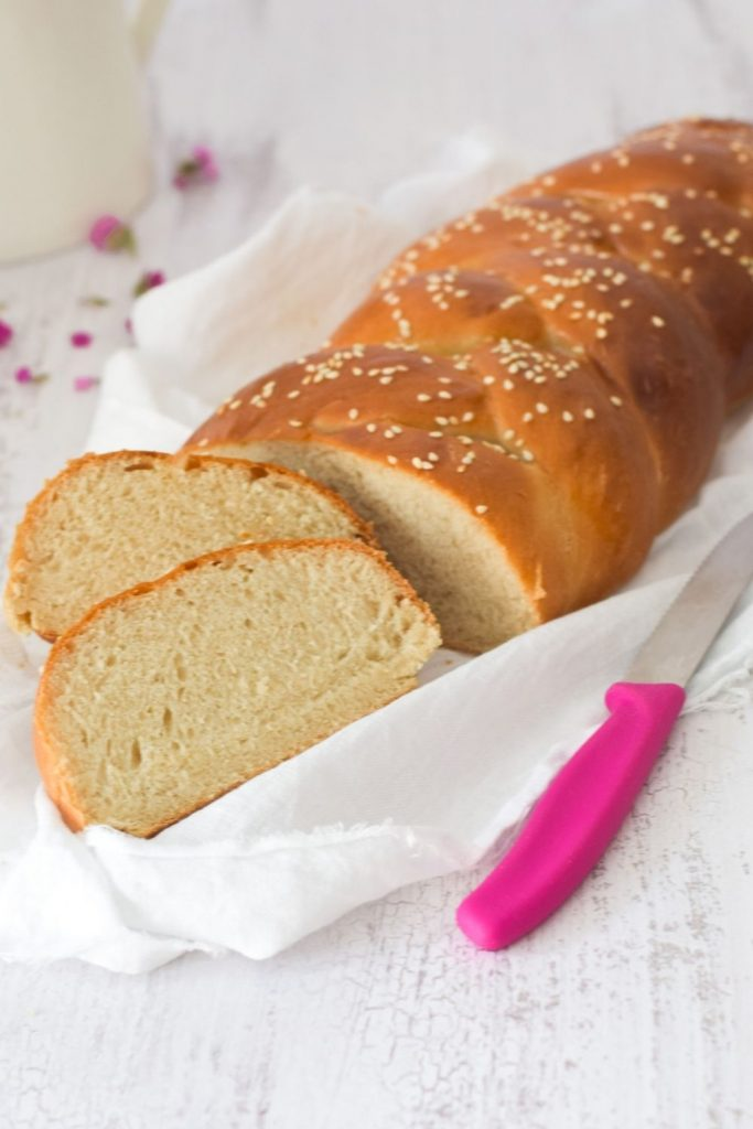 Braided Bread on a white cloth with a pink knife on the side