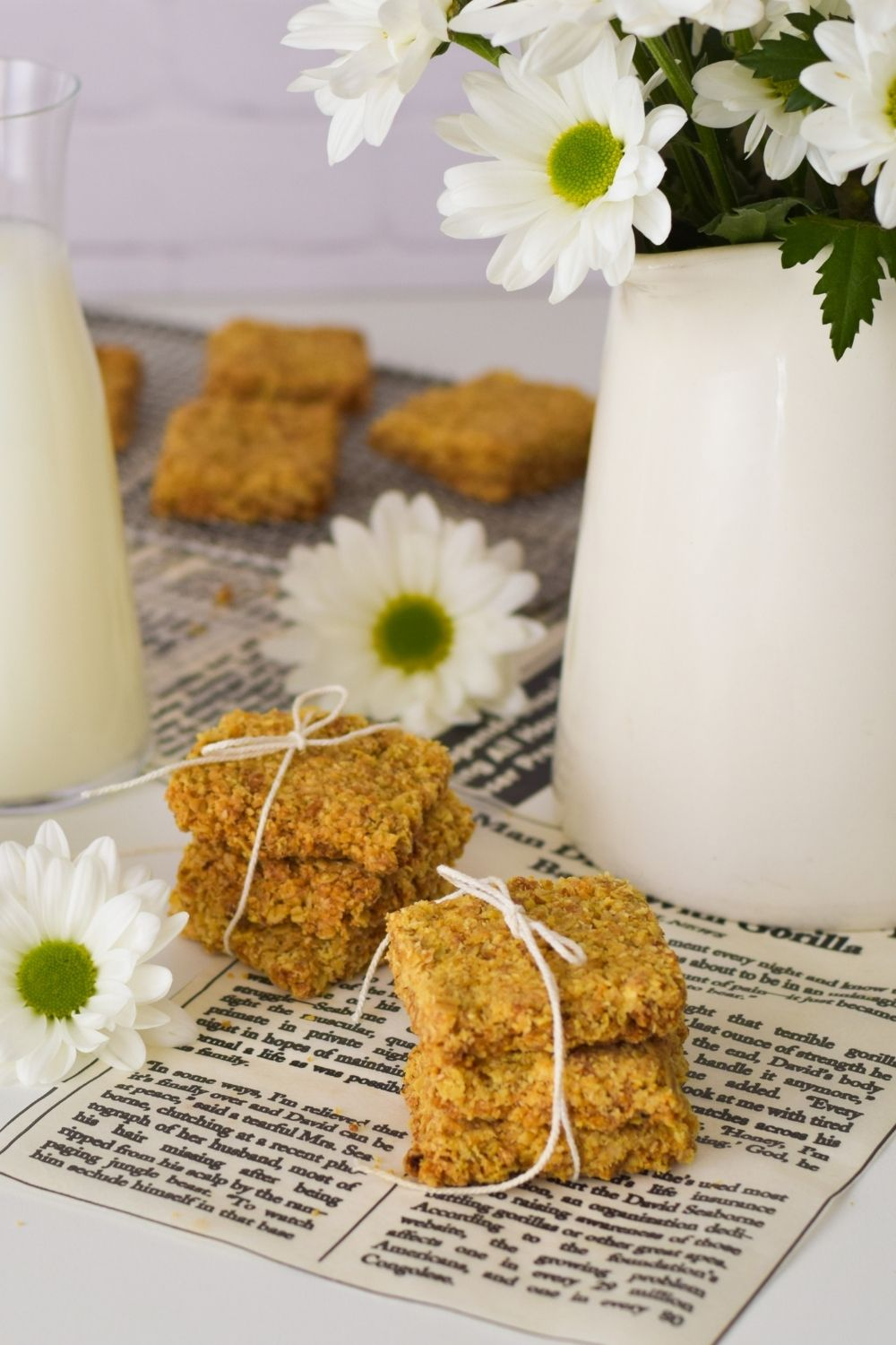 Oat Crunchies tied with string with flowers and a vase on the right