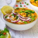 Chickpea Potato Spinach Curry in a white bowl