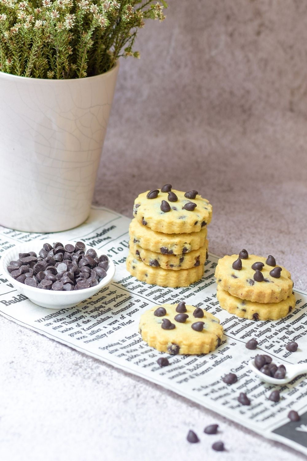 Chocolate Chip Shortbread on newspaper with chocolate chips on left