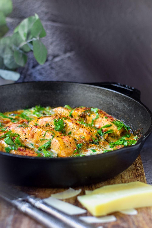 Creamy Tuscan Salmon in a black pan