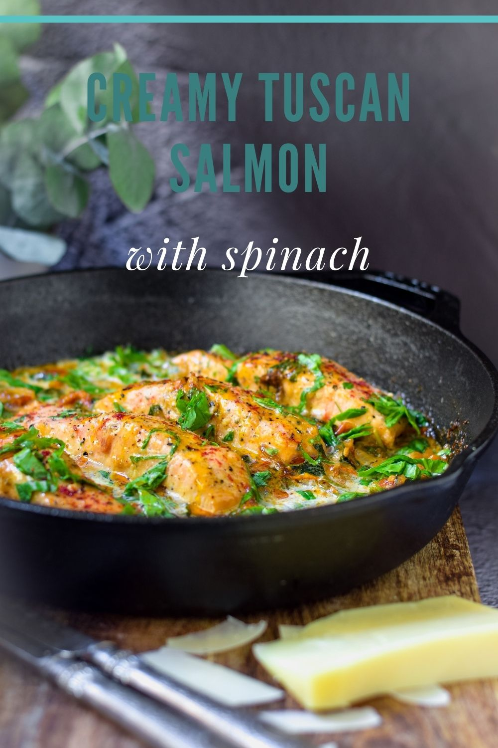 Creamy Tuscan Salmon with Spinach in a black pan